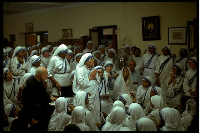 Father Hardon sitting with the Missionaries of Charity